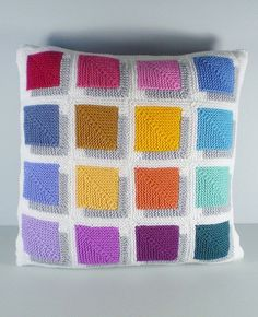 Free Knitting Pattern for Shadow Magic Pillow - This cushion cover is created from mitered magic squares with their own shadow so that the colors seem to float above the surface. Great stash buster for using scrap yarn. Designed by Frankie Brown.