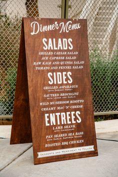 wooden menu sign, photo by Sweet Little Photographs http://ruffledblog.com/modern-palm-springs-wedding #signage #weddingmenu