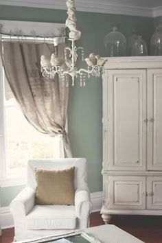 Shabby chic--love the bird chandelier!   Love this paint color and the burlap details!