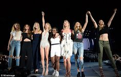 Beauties: Taylor set about recreating the star-studded music video live on stage as part o...