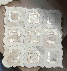 Idée décoration Salle de bain Tendance Image Description Source waterjet marble mix shell decorative mosaic tile on m.alibaba.com