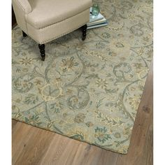 Hand-woven and hand-tufted from natural wool, this Christopher Kashan rug exudes peacefulness and warmth when you are ready to relax. The wool construction and 0.3-inch pile height give the rug a soft