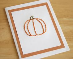 Cool, easy Halloween craft project: Hand stitched pumpkin card.