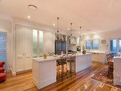 long island bench kitchen white shaker cupboards with beadboard and polished timber floors