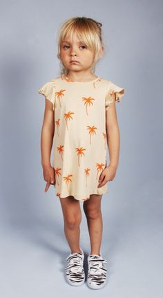 SS13 Bon Voyage!  http://www.minirodini.com/shop/dresses/dresses/mini-rodini-palm-dress