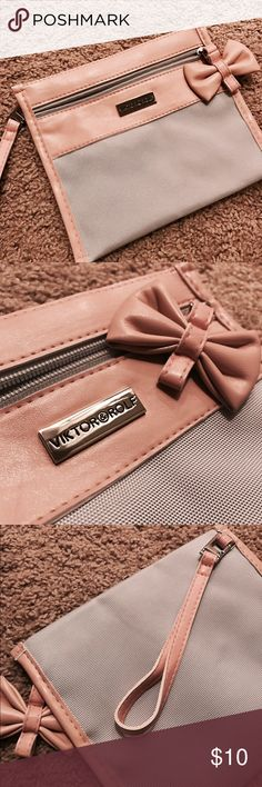 """NWOT Viktor & Rolf travel makeup bag Super cute travel makeup bag/wristlet. Wristlet is removable. Pretty bow zipper. Brand new condition. Approx 6"""" x 7"""" Viktor & Rolf Bags Cosmetic Bags & Cases"""