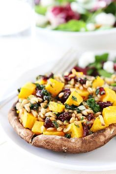 Stuffed Portobello Mushrooms with Farro, Butternut Squash, and Kale-this healthy vegetarian meal is easy to make and a great meal for fall. We love being in the kitchen and cook A LOT, but we still