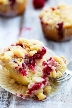 Moist and fluffy raspberry muffins with a lemon streusel crumb topping!