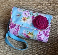 Convertible Cross Body to Clutch Diaper Baby Bag in Jennifer Paganelli's Circa vintage-feel fabrics.  Velvet handmade flower.   Two zippered pockets.  Beautiful, quilted changing pad secures inside with a Velcro tab.  Original design by HolditRightThereBags, $56.00