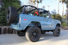 Lifted light blue color Ford Bronco hood off