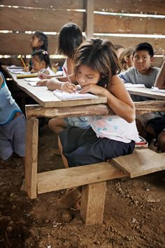 """Aug. 14:  """"School"""" for this Nicaraguan girl consists of a dirt floor and a rudimentary desk within a leaky shed.    This child, however, is lucky to be able to attend school at all. Obtaining an education is a challenge for many destitute children because their struggling families have to pay for education supplies when they can't even afford food for the children to eat. We need your help to change this: www.foodforthepoor.org/noeducation Schools Around The World, People Around The World, Around The Worlds, Honduras, Missionary Pictures, Costa Rica, He Is Lord, Mission Projects, School Kit"""