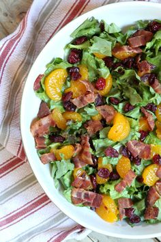 Mandarin Orange Green Salad Recipe with Poppy Seed Dressing - from RecipeGirl.com : perfect salad with mandarin oranges, bacon and dried cranberries in a slightly sweet vinaigrette.  Great holiday salad recipe for fall holidays.
