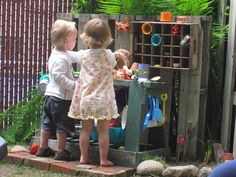 outdoor play station... love the vintage soda crate for toy storage!