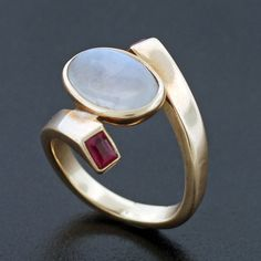 Ring | Antonio Pineda.  14kt gold, Moonstone and ruby.  ca. 1960s.