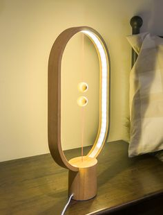 The Heng Balance Lamp Illuminates with a Suspended Magnetic Switch