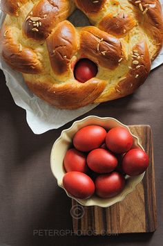 My yiaya makes tsoureki every year on orthodox Easter! So happy to find a recipe since hers is in Greek! Greek Easter bread: scarlet red eggs signify the blood of Christ. Greek Easter Bread, Greek Bread, Greek Sweets, Greek Desserts, Greece Food, Orthodox Easter, Easter Traditions, Easter Eggs, Easter Bun