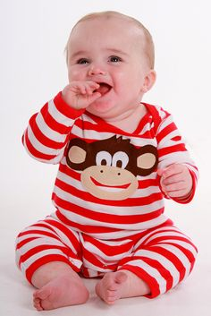 Cheeky monkey, fair trade cotton, baby romper featuring a hand crafted monkey design available in ages 3-24 months.