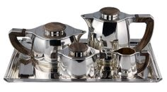 Jean Puiforcat tea and coffee set on tray Sterling silver and ebony. France circa 1930.
