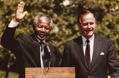 Nelson Mandela and President HW Bush.