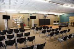 Joshua Gresham from Trailhead Church in Graham, NC brings us this overall youth space. Youth Room Church, Youth Ministry Room, Youth Group Rooms, Kids Church Rooms, Church Lobby, Kids Church Decor, Youth Decor, Church Ideas, Church Interior Design