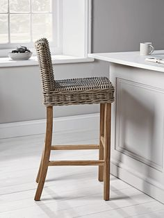 With crafted teak legs and a natural rattan seat, this sturdy stool is both stylish and comfortable. The tawny brown rattan hues will mellow with age, enhancing their look alongside the darker teak wood legs.