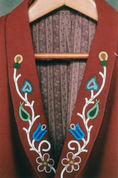 Close-up of lapel area of a wool Metis vest, with floral beading, circa 1850. Louis Riel Institute, Gary Johnson Collection.