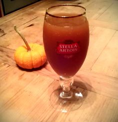 Stella's Cider: 1.5 oz of Pear Grey Goose Vodka, 6 oz of apple cider, and a splash of Ginger Ale.  Perfect autumn drink to imbibe in!