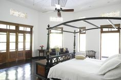 The master bedroom shown here has a private balcony. 'It feels like you're in the trees; there are lots of monkeys and birds,' Ms. Anderson said.