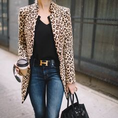 Leopard coat coupled with black top and jeans