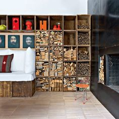 A loft in Florence where architect, Alessandro Capellaro used vintage found boxes to create this modular bookcase which is filled with different sizes of reclaimed wood {Image from Marie Claire Maison, photo by Nicolas Mathéus }.  Like the reclaimed boxes idea.