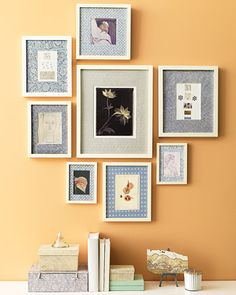 If you love pattern but don't want to commit to wallpaper, try covering the mats of framed artwork with decorative papers. This idea also unites different types of art, bringing them together as a cohesive display.    Use a restrained color palette, like the blues and grays of these block-printed papers; we painted inexpensive wooden frames cream to match one another.