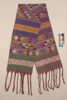 SHAWL OR SASH    ASIAN ETHNOGRAPHIC COLLECTION  Catalog No: 70.2/ 1683     Locale: EASTERN PROVINCE OF BHUTAN (BHUMTHONG)    Country: INDIA    Material: CLOTH (COTTON, SILK)    Technique: DOUBLE FACE OVERSHOT BROCADE; FRINGED    Acquisition Year: 1955 (GIFT)     Donor: DORJI, LHENDRUP      Usually woven in Tashigang district - East Bhutan - but this one is a special royal piece, could be made wherever the court weavers happen to be.  Yablonsky, 1974