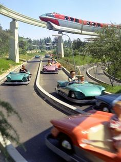 The Walt Disney Company In Disneyland introduced the Bob Gurr-designed monorail, seen here passing over another Gurr creation, the Autopia cars. Note how the Autopia track now had a center guide rail. Disneyland Tomorrowland, Disneyland Resort, Disneyland Parks, Disneyland Photos, Disney Love, Disney Magic, Disney Theme, Disney Stuff, Punk Disney