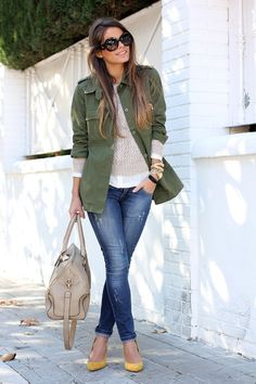 army coat, bag, jeans. That girl is stealing my look:) lol Jk  I wore that outfit last week