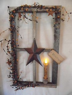 primitive decor~ stained window pane display ~ country ~ timer led candle.  Love these window frames, stars and berries.