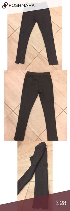 DECKER trendy leggings NWOT! These dark grey leggings are an essential yet unique piece to add to your wardrobe. The front side has a line going down both sides and by the ankle there's a slit. The back has the same lines going down vertically and then begins the knee it stops horizontally. Decker -- Mixology  Pants Leggings
