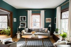 Bold Emerald Green Wall Paint With Mid Century Modern Accents · Green  Living Room ...