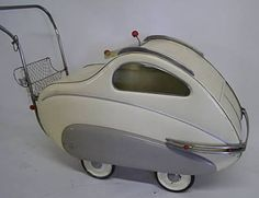 1950′s Italian baby carriage. Love this model with its windows and the ability to seal the baby in from the elements. Very sleek and stylish.