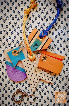 Use an old leather belt and paint pens to make your own DIY tags! Great for kids' backpacks, luggage, and more!