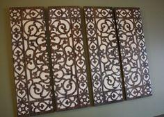Zelf maken : Wand versiering van 4 losse planken met daarop de afdruk van een rubberen deurmat.