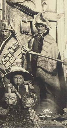 Chilkat dancers pose in ceremonial dress with wood carvings, Alaska, 1895 :: American Indians of the Pacific Northwest -- Image Portion