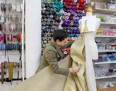 Zac Posen creating a dress in his sewing room.  I love the serger spools on the wall.  It looks quite artistic.