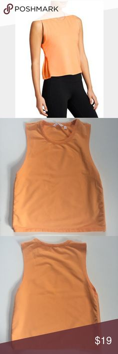 """Athleta Citytime Sweatshirt Tank French terry sweatshirt. Semi-fitted silhouette. Has bigger armholes. Below the armholes there are functional zippers that when opened, reveal mesh ventilation. Color is tiger lily orange heather. Length is approx. 21 1/2"""". In very good, pre-owned condition. ❌NO TRADES❌NO PAYPAL❌ Athleta Tops Tank Tops"""