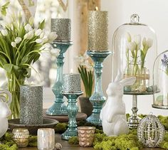 Gotta Love Pottery Barn! I love the glass cloche over the tulips and eggs. A fun new idea beyond simple apothacary jars. The bunnies with moss around their feet are cute too!