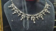 A petite diamond tiara necklace combination, circa 1890s, with seven floral pinnacles and six smaller spacers.