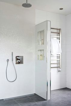 These sparkling touches in the a white bathroom give it a luxury designer feel