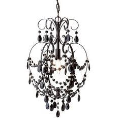 black chandelier above tub