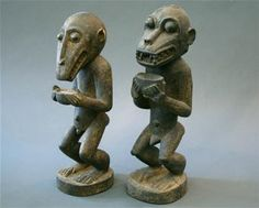 Two African tribal hand carved wooden monkeys