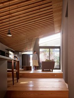 wood slats on the ceiling make the space seem larger than it really is