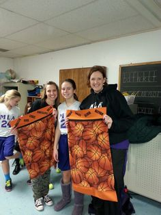 Julia Morgan Almstedt played on the Martin Luther Academy's J V BASKETBALL TEAM. Here Julia is pictured with Coach Edwards and Coach Engle with their pillowcase gifts from Julia which Heidi Scroggins sewed. Coach Bragato is not pictured because he was working in FL that weekend but he also received a pillowcase.